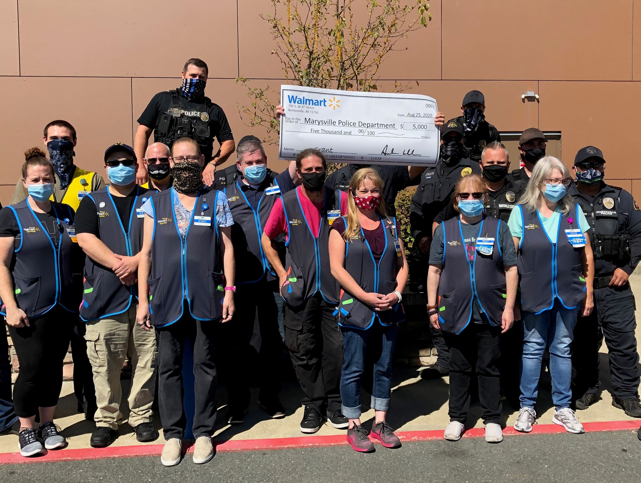 Marysville Police at Walmart with $5000 grant check