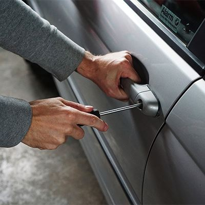 A person tries to break into a car