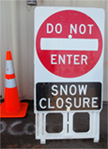 snow closure sign